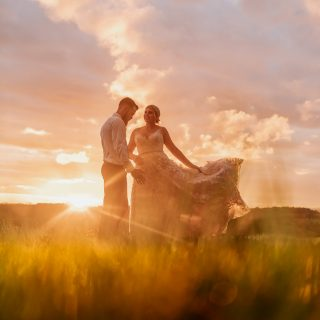 Byron View Farm Wedding bride and groom at sunset with amazing coloured sky