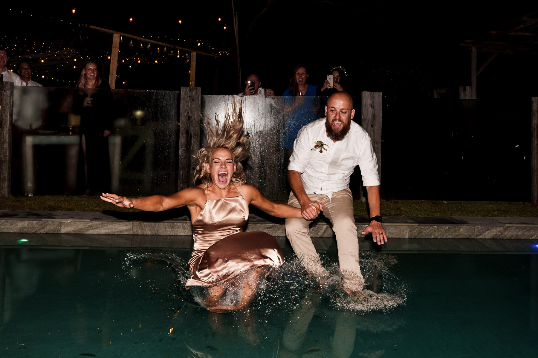 Toolaroo Farm Stay Wedding Byron Bay Bride and Groom Jumping in Pool