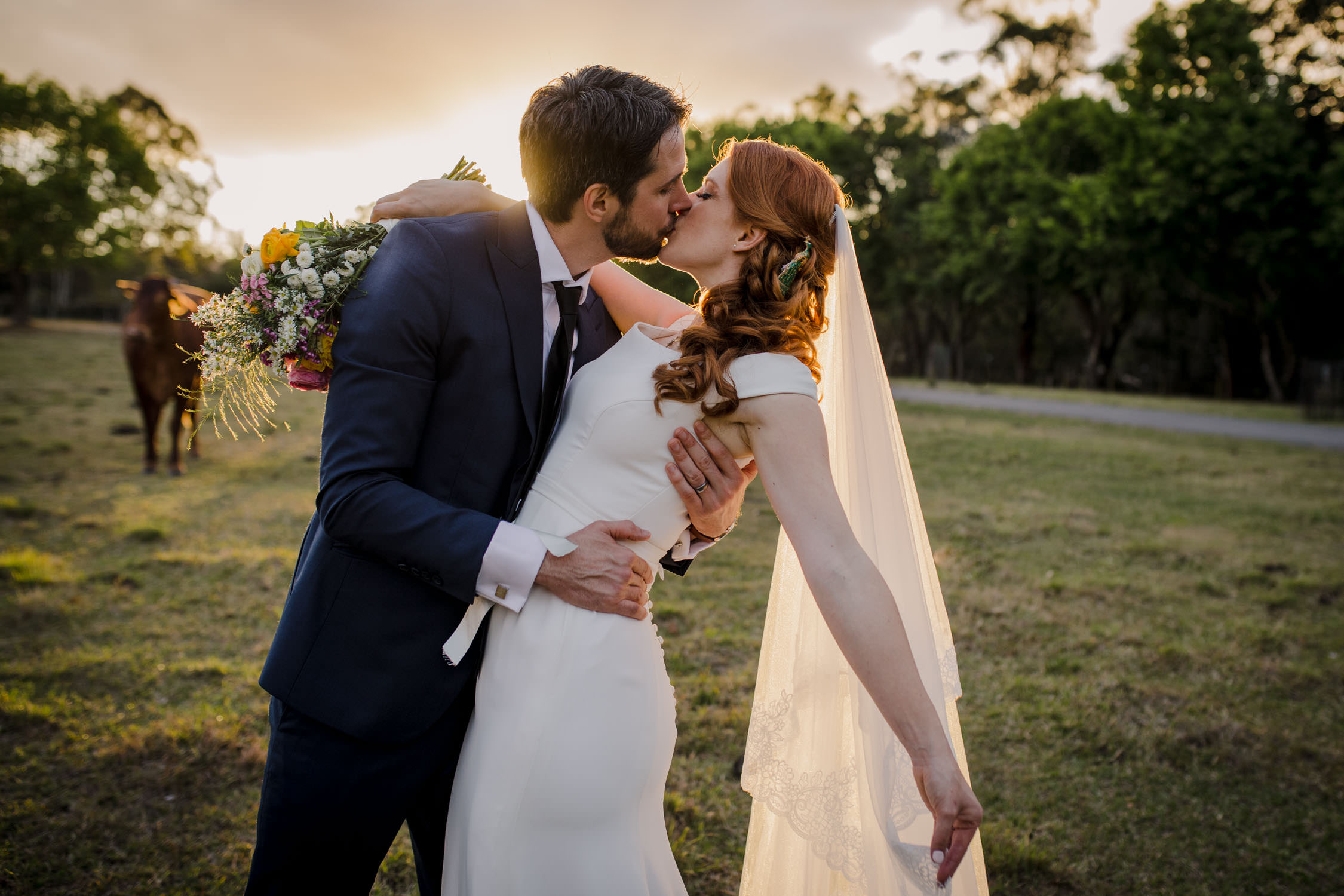 Bundaleer Rainforest Gardens Wedding Bride and Groom kissing at sunset
